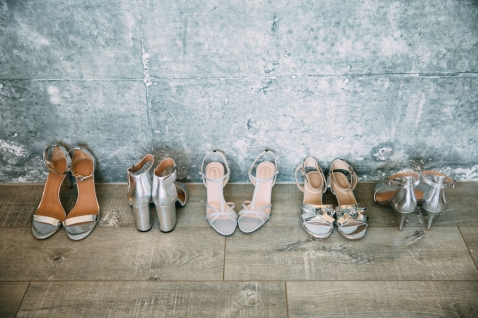 Silver high heels photographed by Bright Bird Wedding Photography