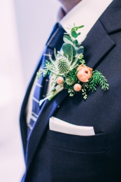 Wedding boutonniere photographed by Bright Bird Wedding Photography