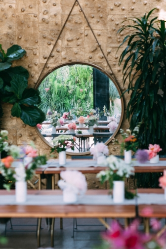 Circular mirror with flowers photographed by Bright Bird Wedding Photography