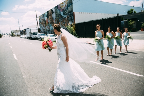 Bride walking with bridesmaids photographed by Bright Bird Wedding Photography