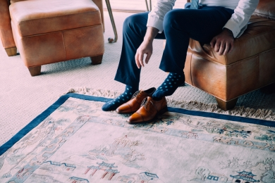 man-putting-on-dress-shoes