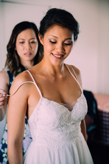 bride-getting-ready-with-bridesmaid