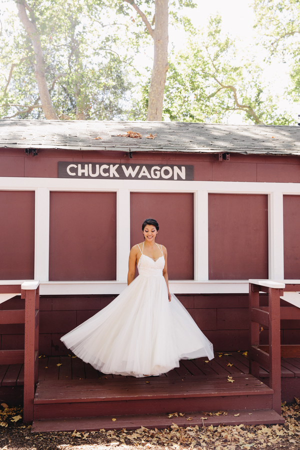 bride-spinning-in-wedding-dress-outside