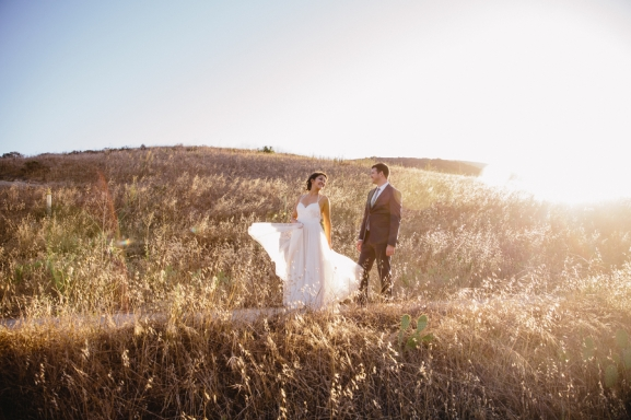 bride-and-groom-in-field