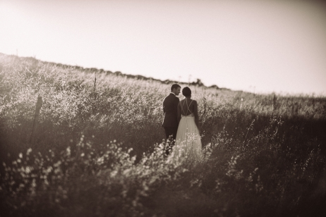 bride-and-groom-standing-in-field