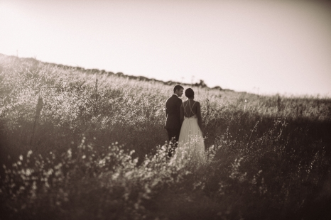 bride-and-groom-standing-in-field