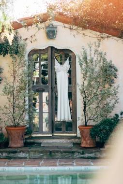 wedding-dress-hanging-in-window-outside