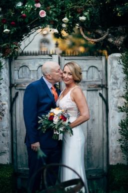 bride-kissed-on-cheek-by-groom