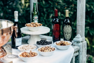 wine-an-bowls-of-nuts-on-table