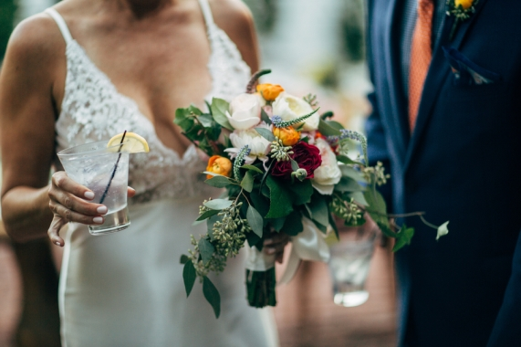 bride-holding-bouquet-and-cocktail