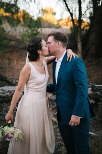 bride-and-groom-kissing-outside