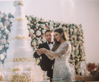 film-photograph-of-bride-and-groom-cutting-wedding-cake