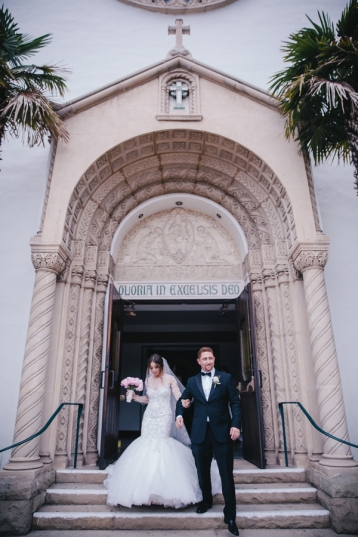 bride-and-groom-walking-out-of-church