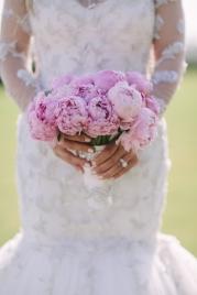 bride-holding-purple-bouquet