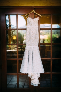 wedding-gown-hung-by-window
