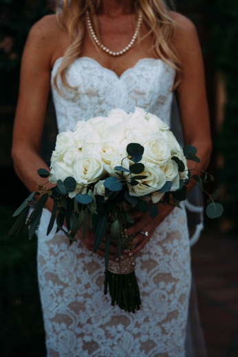 bride-holding-white-rose-bouquet