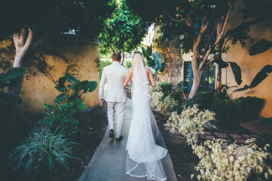 bride-and-groom-walking-outside