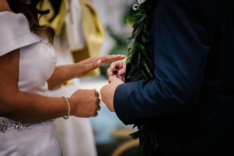 groom-placing-ring-on-bride-finger