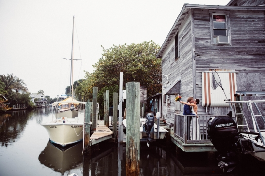 bride-and-groom-kissing-by-water