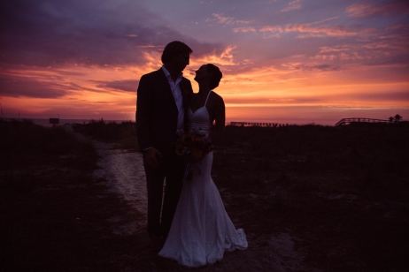 bride-and-groom-on-beach-at-sunset