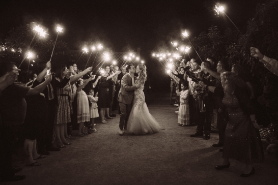 bride-and-groom-kissing-under-sparklers