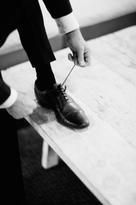 man-tying-dress-shoes