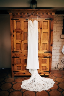 wedding-dress-hung-on-cabinet