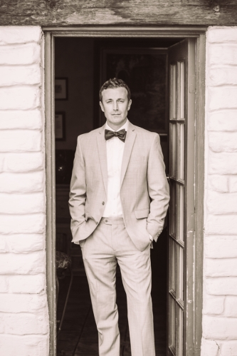 man-in-suit-with-bow-tie