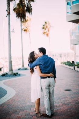 couple-kissing-on-beach-boardwalk