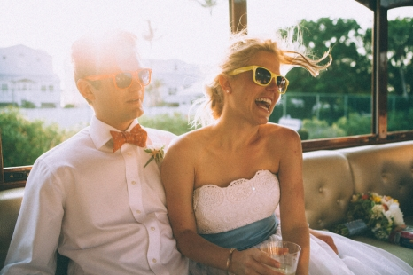 bride-and-groom-sitting-wearing-sunglasses