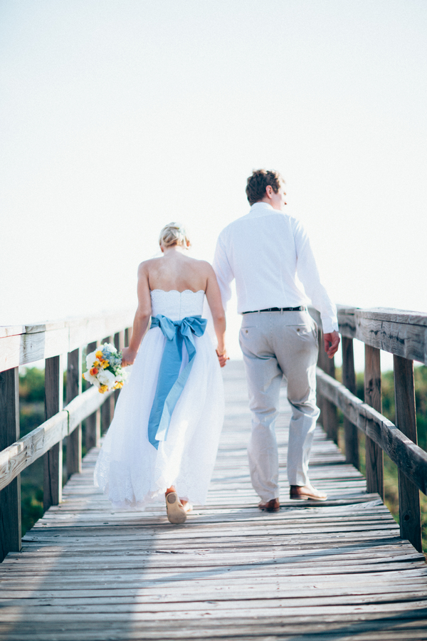 bride-and-groom-walking-on-wooden-bridge