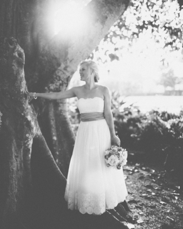 black-and-white-photo-of-bride-by-tree