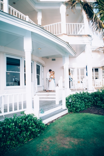 bride-and-groom-kissing-on-porch
