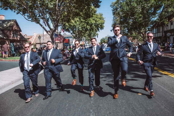 men-in-suits-running-in-street