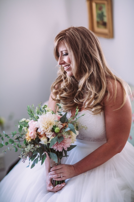 bride-posing-with-boquet