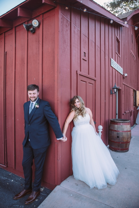 bride-and-groom-handing-hands-outside