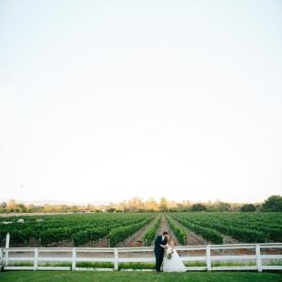 bride-and-groom-kissing-in-vineyard