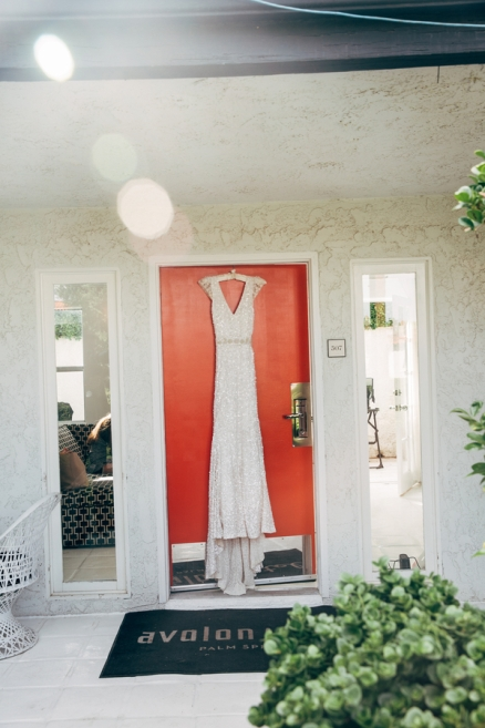 wedding-dress-hanging-on-door