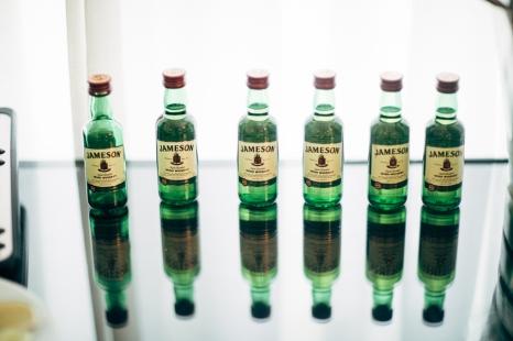 six-jameson-shot-bottles-on-reflective-table