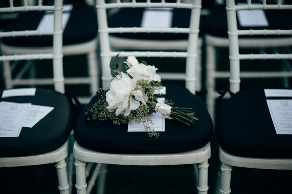 white-bouquet-on-black-chair