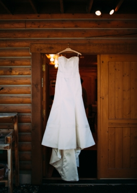 wedding-dress-hanging-in-a-cabin