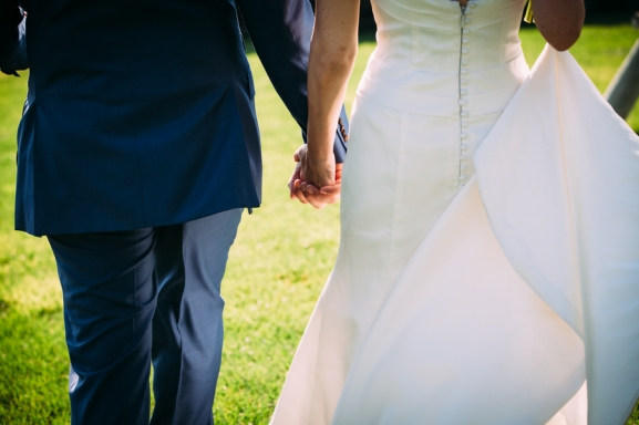 bride-and-groom-holding-hands-close-up